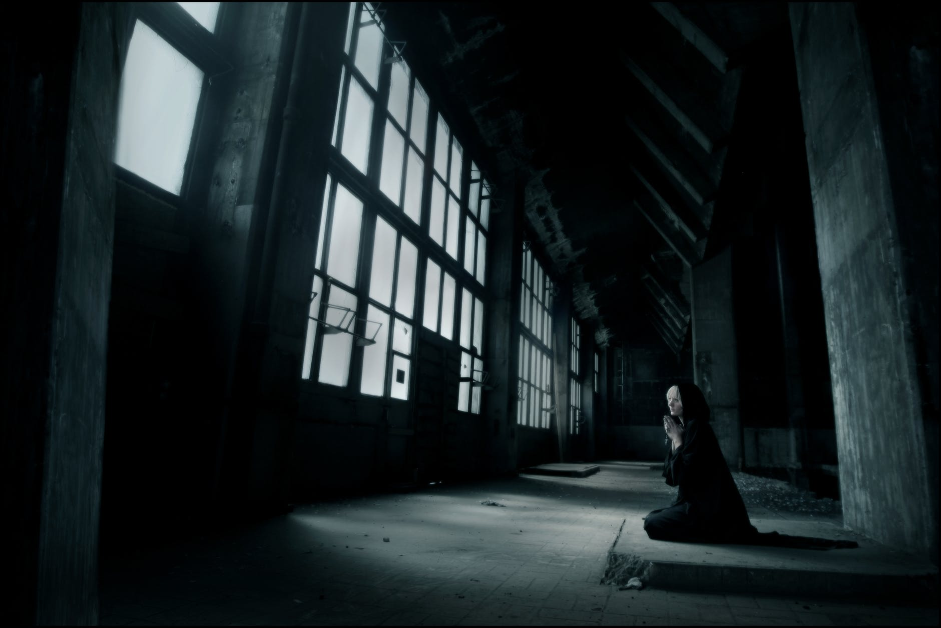 woman praying inside building